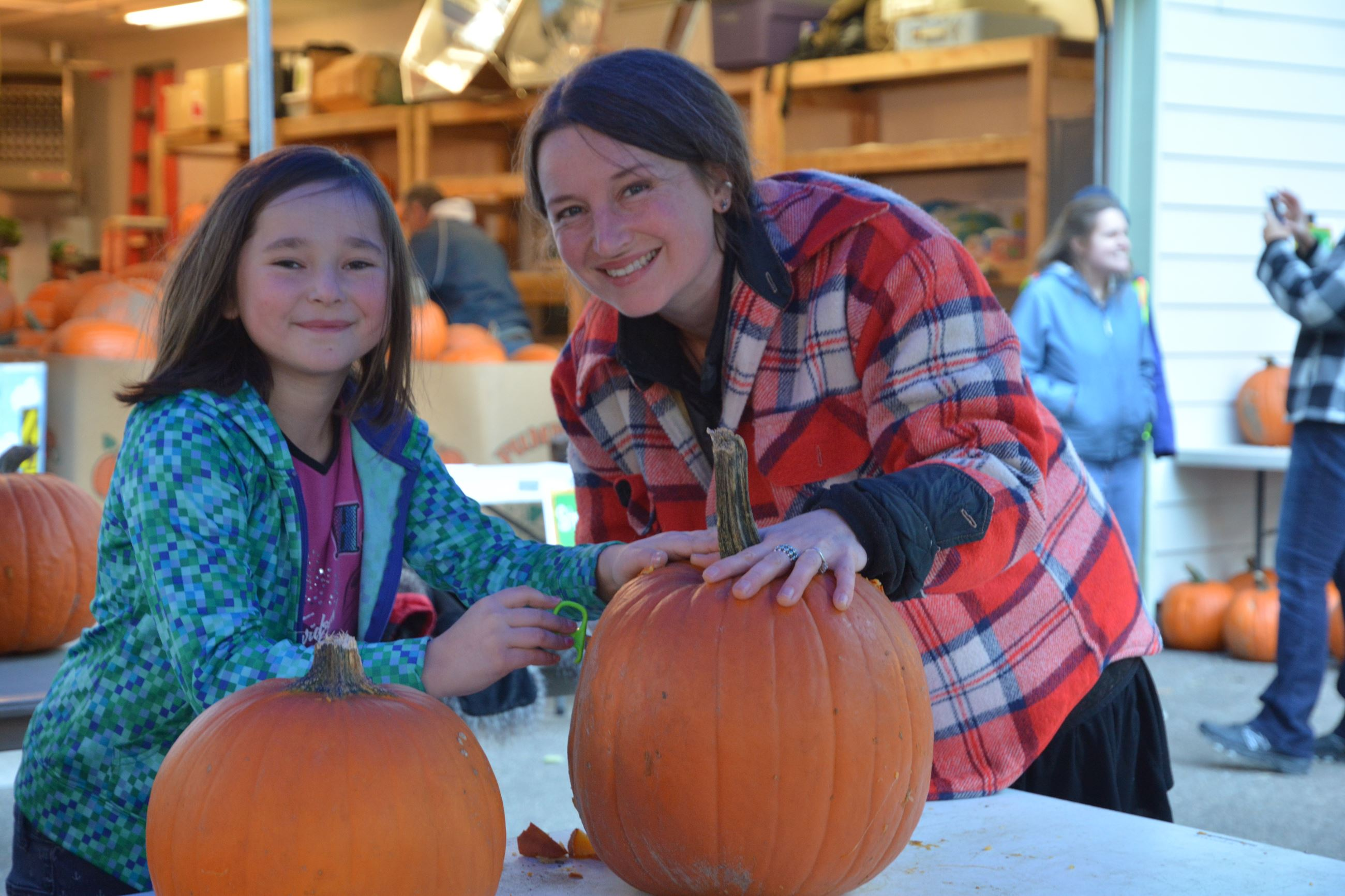 Community Members Carving Pumpkins